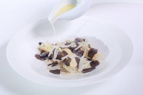 Asparagus fricassée, truffle and parmesan bouillon